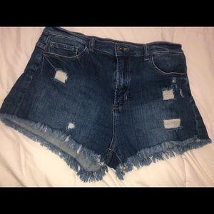 Moderate high rise denim shorts